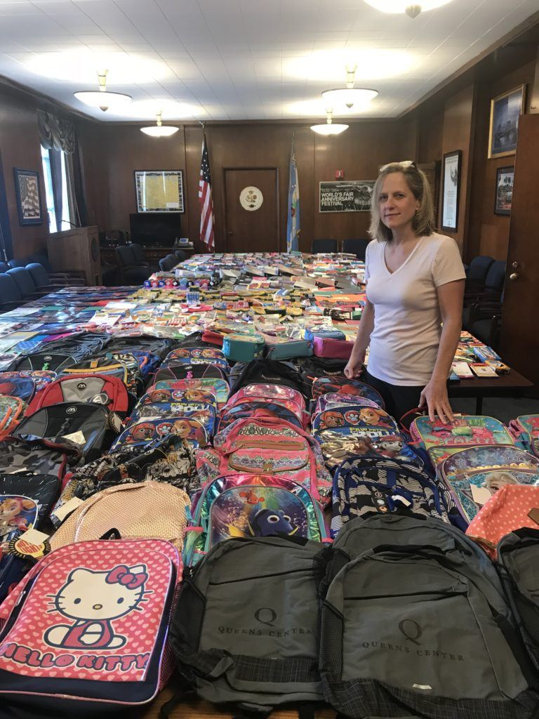 Queens Borough President Melinda Katz with rows of backpacks and school supplies at Queens Borough Hall
