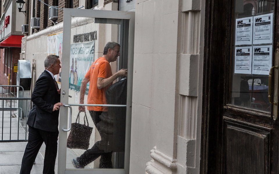 Mayor de Blasio followed by a Security Guard entering the Prospect Park YMCA