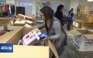 Coalition staff sort donated toys in boxes
