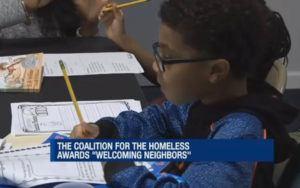 A boy does homework as part of a shelter tutoring program.