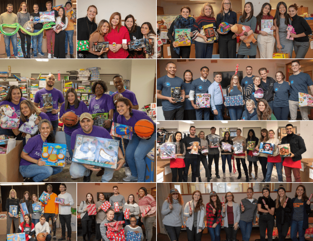 Many groups of volunteers holding toys