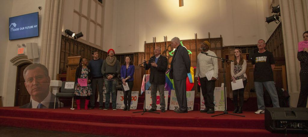 Advocates standing on stage at the House Our Future NY Town Hall