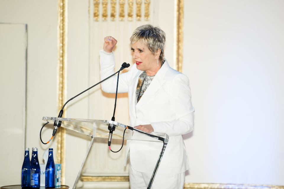 Eve Ensler on stage at the 25th Anniversary Woman Mean Business Luncheon