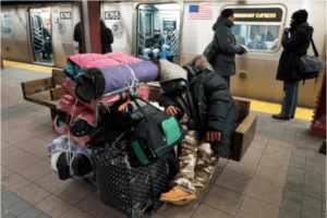 Person sleeping on a subway bench