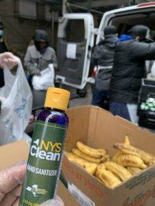 blue bottle that reads NYS Clean HAND SANITIZER box of bananas